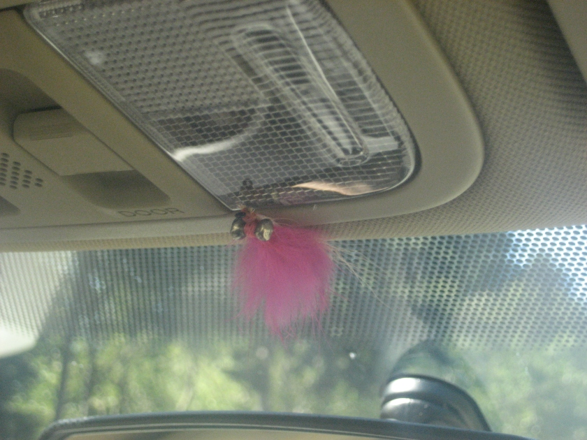 A pink fly for fly fishing.