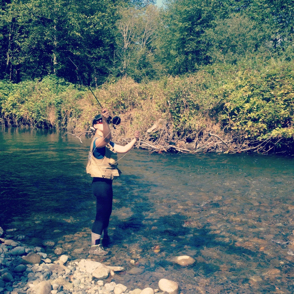 Woman casting a fly rod.